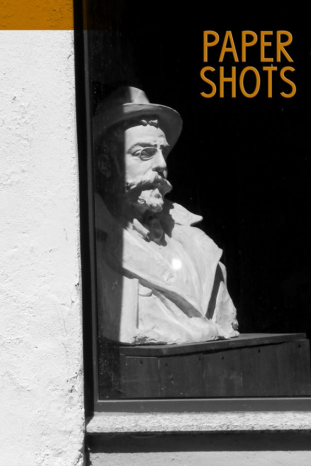 paper shots man window